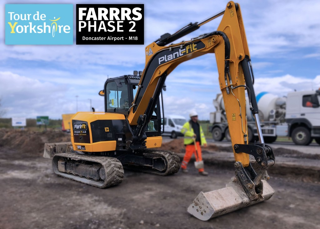 Plant-fit's excavator is shown working at Rossington for the FARRRS project & tour de yorkshire